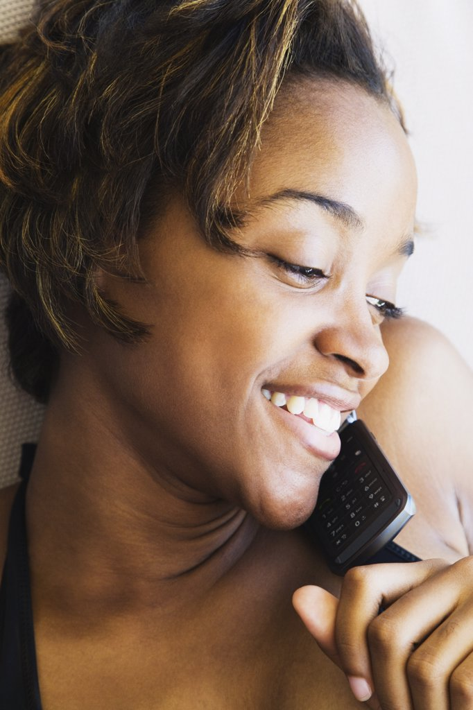 African woman talking on cell phone : Stock Photo