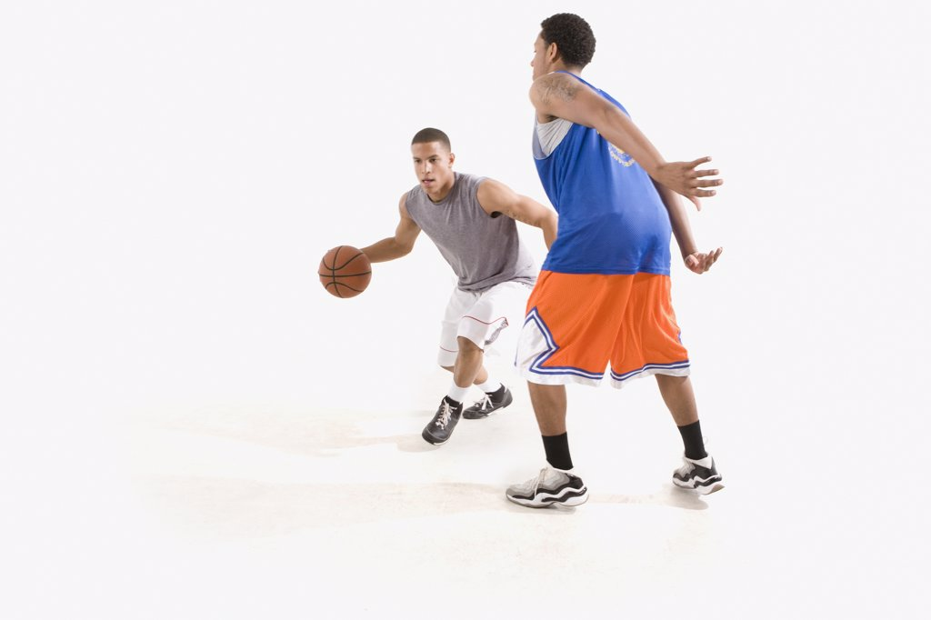 Stock Photo: 1589R-77893 Men playing basketball