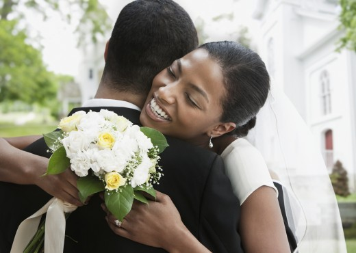 Bride and groom hugging : Stock Photo