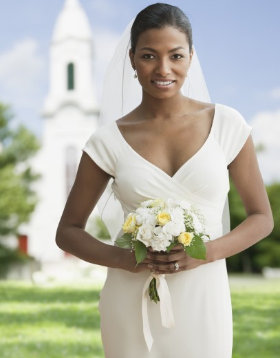 Stock Photo: 1589R-77980 African bride holding bouquet
