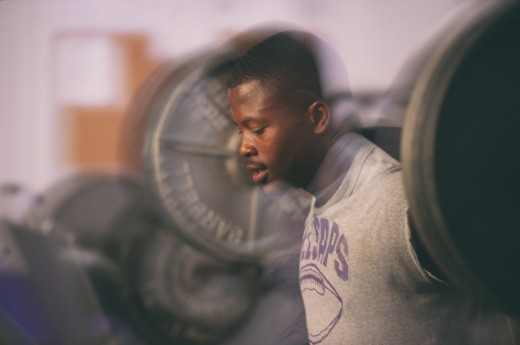 Stock Photo: 1589R-78145 African man weight lifting with barbell