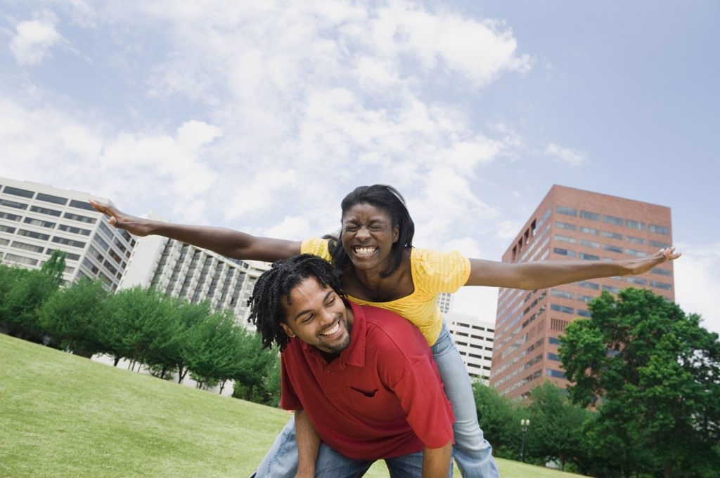 Stock Photo: 1589R-78840 Playful couple in urban park
