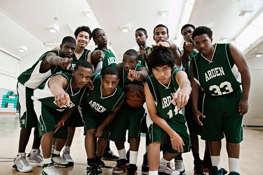 Stock Photo: 1589R-78924 Basketball players pointing at camera in gym