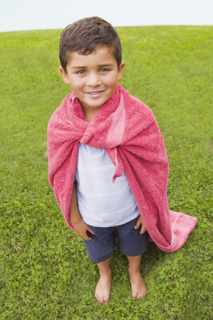 Hispanic boy wearing towel cape : Stock Photo