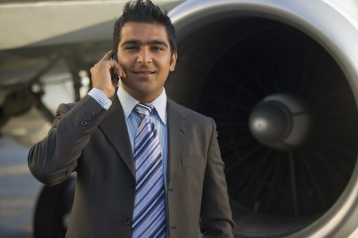 Stock Photo: 1589R-79328 Middle Eastern businessman in front of jet engine