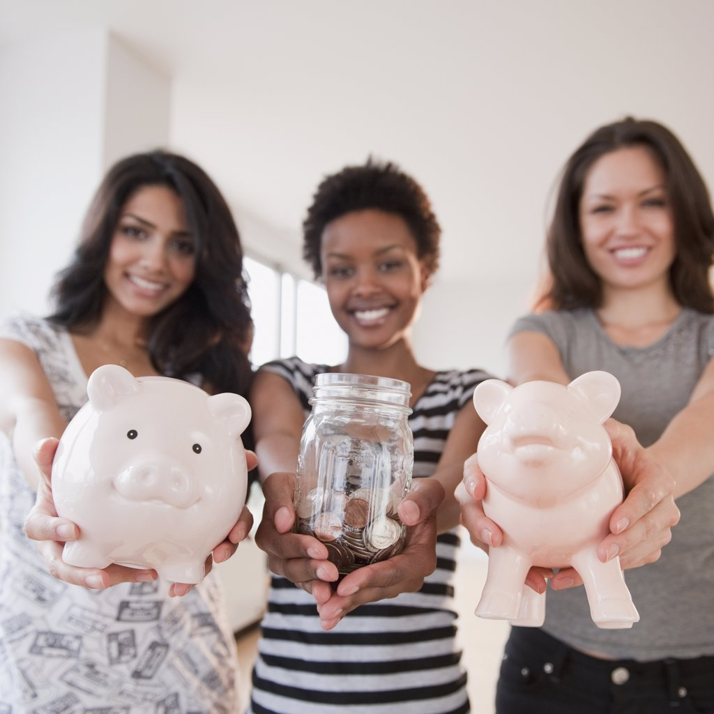 Stock Photo: 1589R-79593 Friends holding out glass jar and piggy banks