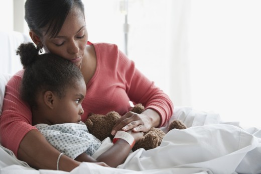 Stock Photo: 1589R-79680 Mixed race mother comforting child in hospital bed