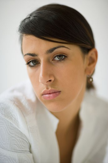Stock Photo: 1589R-80575 Serious mixed race woman