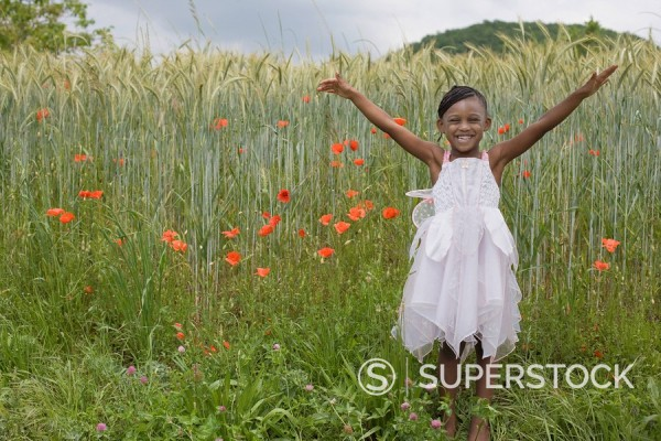 Stock Photo: 1589R-83787 African girl wearing fairy costume in grass