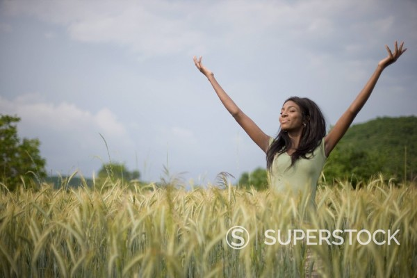 Stock Photo: 1589R-83847 Carefree African woman in field