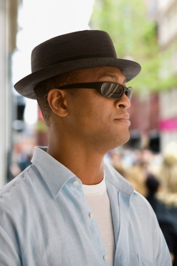 African man in hat and sunglasses : Stock Photo
