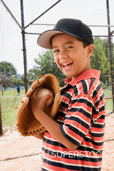 Stock Photo: 1589R-85207 Mixed race boy playing baseball