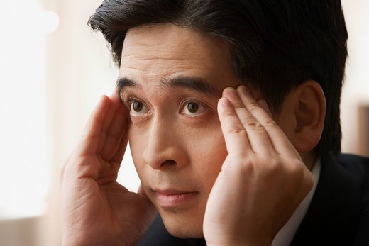Stock Photo: 1589R-85305 Chinese businessman rubbing forehead