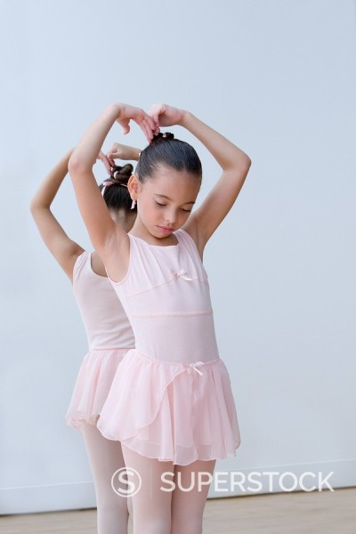 Stock Photo: 1589R-85459 Hispanic girl practicing ballet in tutu