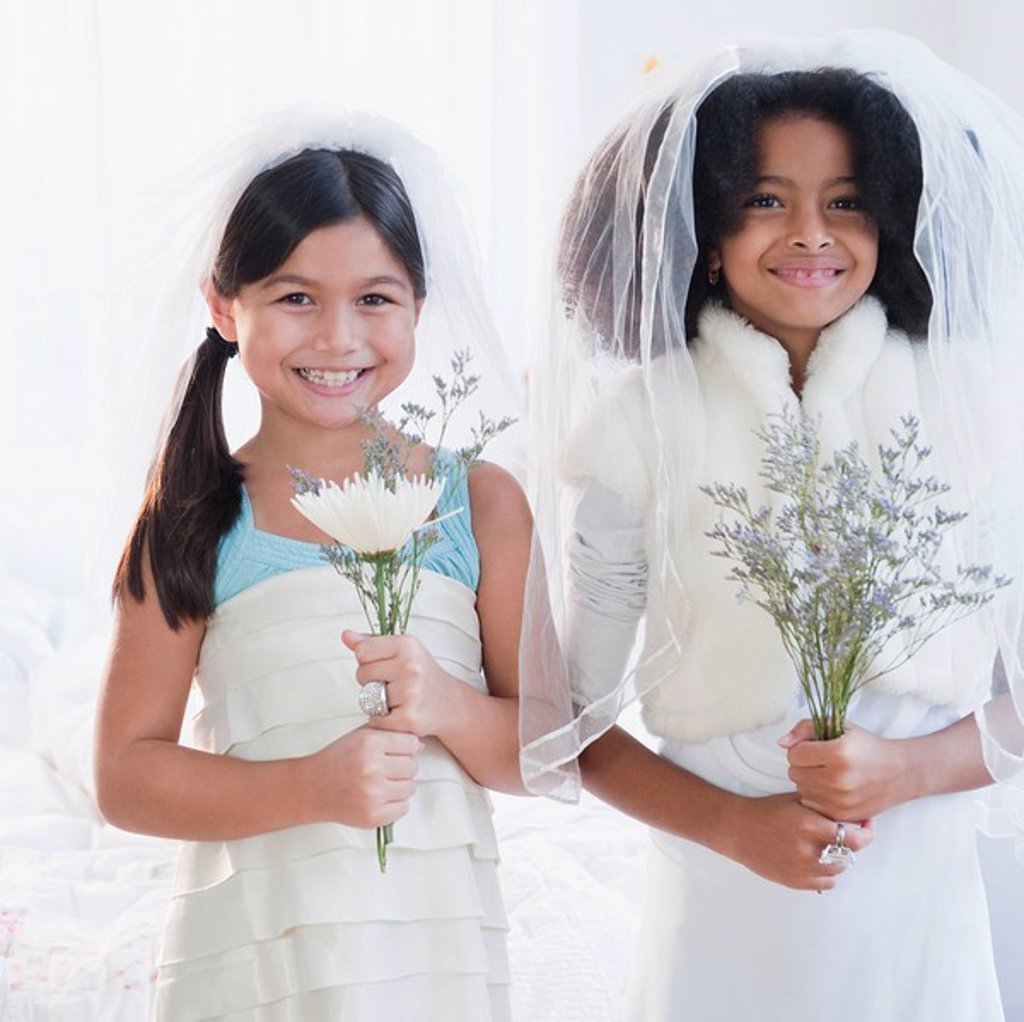 Stock Photo: 1589R-86209 Girls dressing up in wedding dress