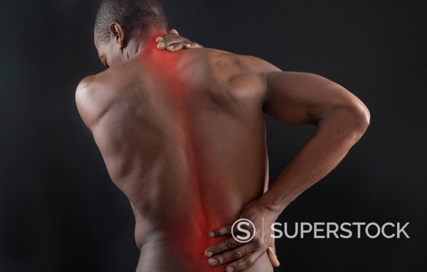 Stock Photo: 1589R-86333 African American with glowing aches in back