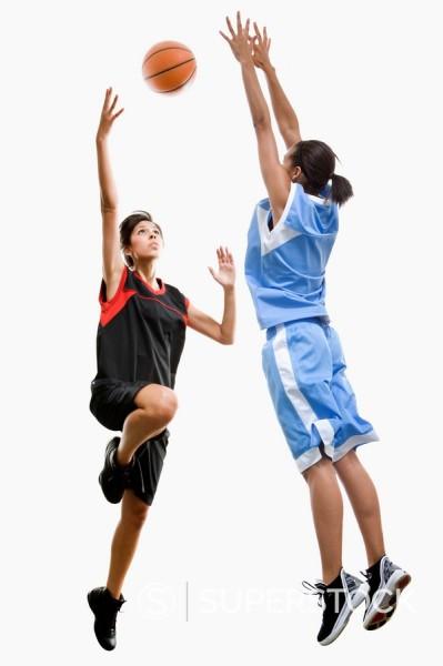 Mixed race women playing basketball : Stock Photo