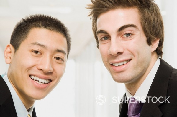 Stock Photo: 1589R-86975 Businessmen smiling