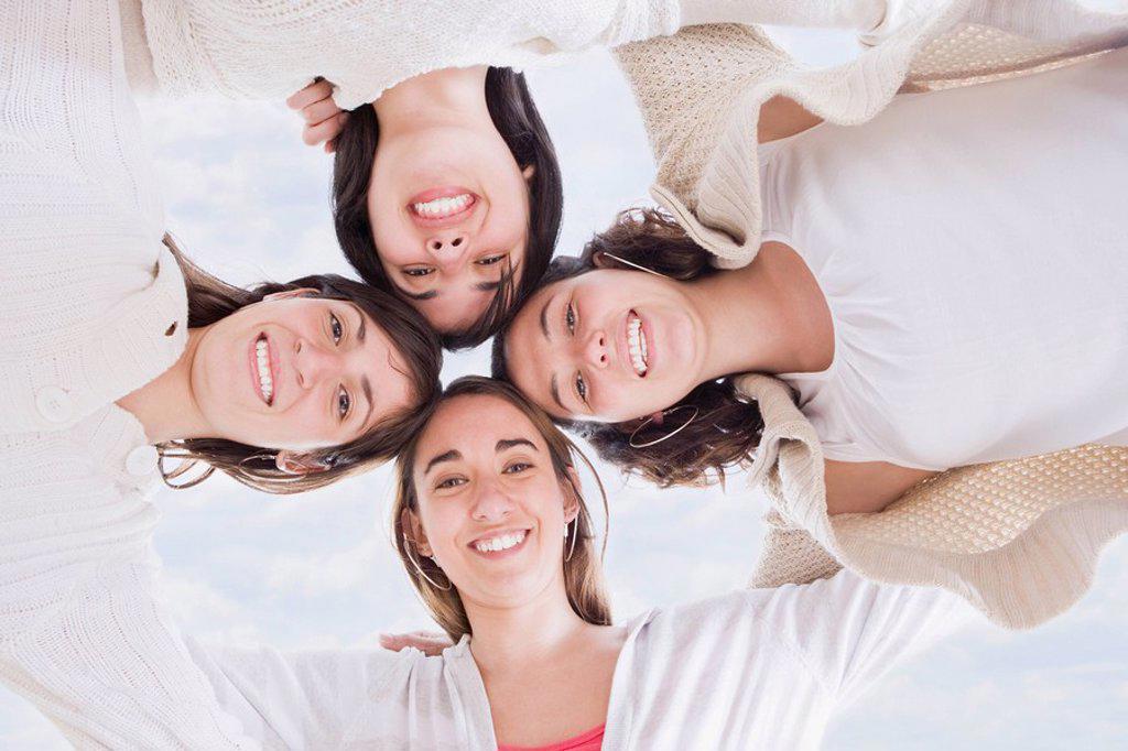 Stock Photo: 1589R-87333 Hispanic women hugging in circle