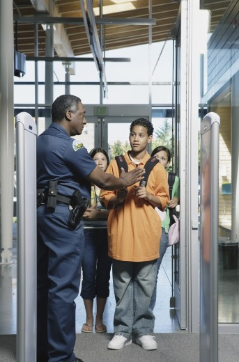 Security officer stopping teenager : Stock Photo