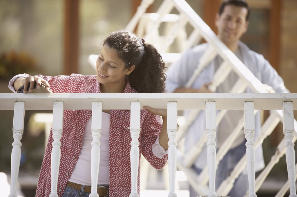 Couple fixing railing : Stock Photo