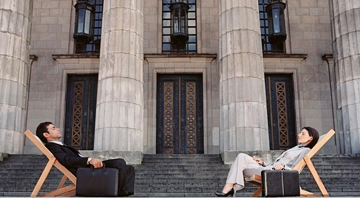 Stock Photo: 1589R-99504 Businesspeople in lounge chairs in front of building
