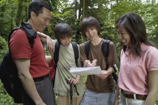 Stock Photo: 1589R-9996 Family checking map while hiking