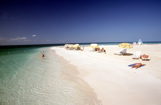 Stock Photo: 1590-1059 Mexico, Isla Mujeres, Playa Cocteros, People sun bathing on sandy beach