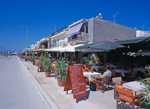 Stock Photo: 1590-1107 Greece, Kos Island, Kardemena, People relaxing in sidewalk cafe