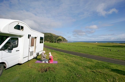 Stock Photo: 1590-588 New Zaeland, Aupouri Peninsula, Cape Reinga, Mother with two children near camper van