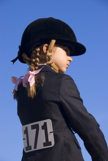 Side profile of a girl in equestrian clothing, Jefferson, Oregon, USA : Stock Photo