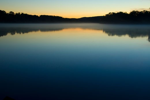 Stock Photo: 1596-1197A Reflection of trees in a river at dawn, Connecticut River, Ferry Park, Rocky Hill, Connecticut, USA