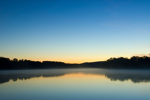 Reflection of trees in a river at dawn, Connecticut River, Ferry Park, Rocky Hill, Connecticut, USA : Stock Photo