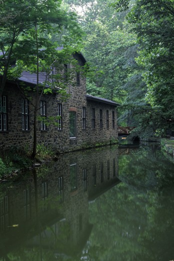 Stock Photo: 1596-1603A Reflection of an industrial building in water, Hagley Museum and Library, Wilmington, Delaware, USA