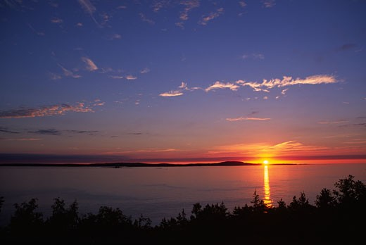 Sunrise over the sea, Frenchman Bay, Acadia National Park, Mount Desert Island, Hancock County, Maine, USA : Stock Photo