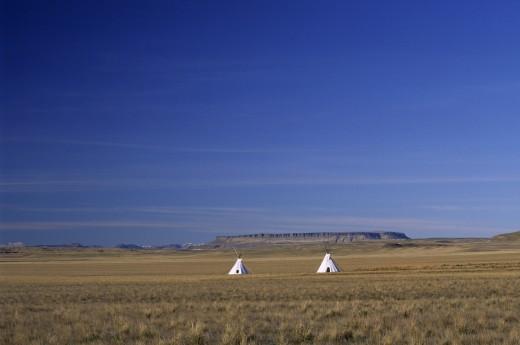 Teepees on a prairie, Ulm Pishkun State Park, Montana, USA : Stock Photo
