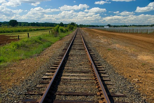 Railroad track passing through a landscape, Marion County, Oregon, USA : Stock Photo