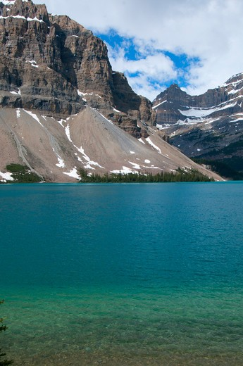 Lake with a mountain range in the background, Bow Lake, Banff National Park, Alberta, Canada : Stock Photo
