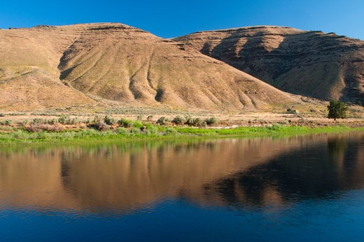 Stock Photo: 1596-2791 Reflection of hills in water, John Day River, John Day River State Scenic Waterway, Murtha Ranch, Oregon, USA