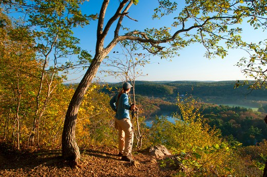 Stock Photo: 1596-2944 USA, Connecticut, New England National Scenic Trail, Hiker looking at Bluff Head ridge along Mattabesett Trail