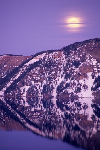 Stock Photo: 1596-2999 Moonrise over a lake, Crater Lake, Crater Lake National Park, Oregon, USA