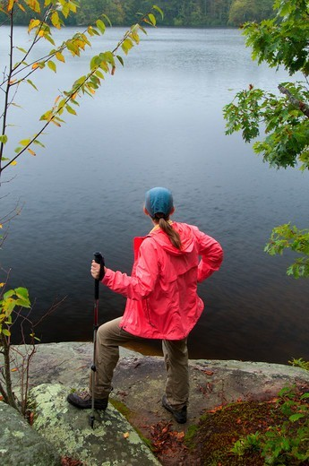 Female hiker at Green Fall Pond along Narragansett Trail, Pachaug State Forest, New London County, Connecticut, USA : Stock Photo