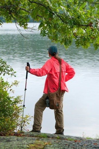 Stock Photo: 1596-3270 Female hiker at Green Fall Pond along Narragansett Trail, Pachaug State Forest, New London County, Connecticut, USA