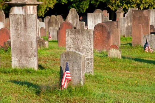 Headstones with American flag at Palisado Cemetery, Windsor, Hartford County, Connecticut, USA : Stock Photo