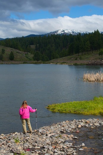 Stock Photo: 1596-3701 USA, Oregon, Bates State Park, Tourist at Bates Pond