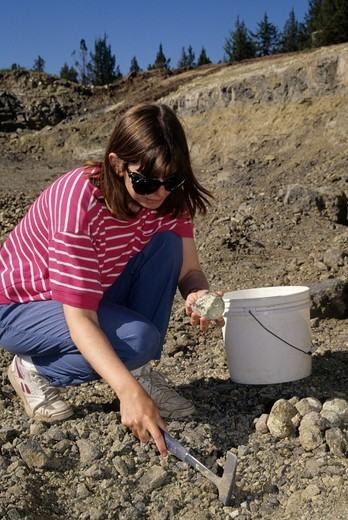 USA, Oregon, Richardson's Rock Ranch, Woman digging for thunderegg : Stock Photo