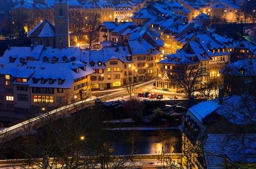 Bern, Switzerland, canton Bern, town, city, capital, Old Town, dusk, houses, homes, snow, winter, lights, illumination, street, traffic : Stock Photo
