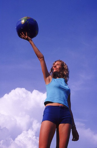 Stock Photo: 1597-108689 actively, ball hold up, fitness, freedom, future, globe, healthy, joy, liberty, person, sky, sports, symbol, Woman,