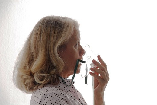 Stock Photo: 1597-109989 elderly woman, older, elder, woman, profile, mask, oxygen mask, oxygen, breathing, air, lung, medicine, seniors, studi