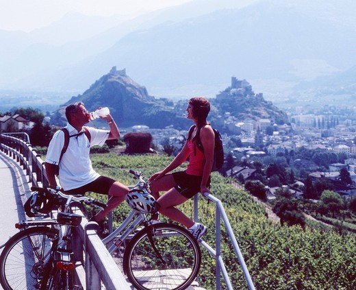 Stock Photo: 1597-110022 couple, rest, biker, bicycle tour, break, stop, summer, Rhone route, Sion, Canton Valais, Switzerland, Europe, bicycle